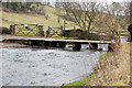 SK2063 : Clapper Bridge over River Bradford by John Sparshatt