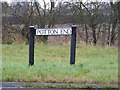TL2659 : Potton Road sign by Adrian Cable