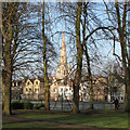 TL4558 : Tennis courts, the back of King Street and All Saints' spire by John Sutton