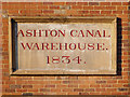 SJ9398 : Ashton Canal Warehouse Plaque by David Dixon