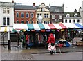 TL4458 : Cambridge Market: bright colours on a drab December day by John Sutton