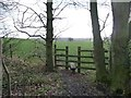 SE2706 : Footpath stile at the edge of Bentcliff Hill Plantation by Christine Johnstone