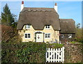 SP2642 : Cottage in Honington by Graham Horn