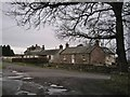 NH5755 : Cottages in Easter Kinkell by Richard Dorrell