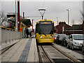"""Metrolink Bombardier M5000 tram 3045 departs Droylsden Tram Station after picking up passengers for the return journey towards Manchester. Although the line from Piccadilly to Droylsden wasn't officially opened until 11th February, this tram was operating as part of a free service as a """"thank-you"""" to residents living next to the route (http://www.manchesterconfidential.co.uk/News/Droylsden-Metrolink-Route-Opening-Imminent  Manchester Confidential).  The new Droylsden Tram stop on Ashton Road, just to the east of Market Street, will operate as the temporary terminus for the Metrolink East Manchester Line Extension; a facing connection allows trams from the outbound platform to move forward and onto the inbound line to reverse and return towards Manchester. The East Manchester line will eventually run to Ashton-Under-Lyne.  http://www.lrta.org/Manchester/ashton.html LRT Association """"Metrolink - Manchester to Droylsden and Ashton-Under-Lyne"""" http://www.metrolink.co.uk/futuremetrolink/Pages/east-manchester-line.aspx Transport for Greater Manchester - Metrolink East Manchester Line"""
