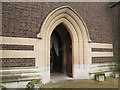 TQ2870 : St Barnabas church, Mitcham: west entrance by Stephen Craven