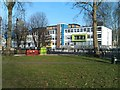 TQ2583 : Colourful secondary school buildings at Kilburn Park by David Martin