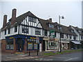 Dist:0.3km<br/>Mock Tudor row with housing above the street level shops.