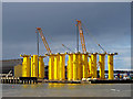 SJ3388 : Wind turbine monopiles at Camell Laird dock by William Starkey