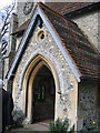 TQ3859 : Porch of St Leonard's church by Stephen Craven