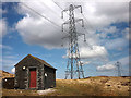 NY5607 : Small hut and pylons, Birkbeck Fells Common by Karl and Ali