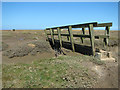 TF9744 : Bridge over tidal creek in Stiffkey salt marshes by Evelyn Simak