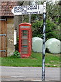 ST6520 : Poyntington: phone box and finger-post by Chris Downer