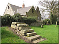 Dist:0.1km<br/>The church guide refers to this mounting block by a local dialect name.