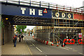 Dist:0.2km<br/>The distinctive FERODO lettering on the railway bridge over Caledonian Road in the process of being painted over as part of an area rebranding exercise - the Camden Road railway bridge has recently received similar treatment.