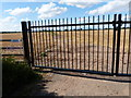 SP3396 : Gates across the track to Barn Farm by Mat Fascione
