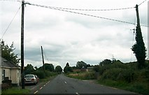 N0819 : Power lines crossing the R357 (Hill Street) on the eastern outskirts of Cloghan by Eric Jones