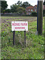 TG1915 : Home Farm sign by Adrian Cable