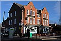 Situated on the B5129 Chester Road West, just outside the high-level railway station.