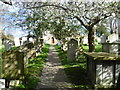TQ6573 : Path to the west door of Milton Church by Marathon