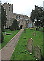 TL2064 : Great Paxton church and churchyard by John Sutton