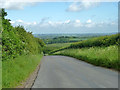 SP9515 : View from road down the downs by Robin Webster