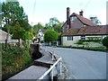 SU0255 : 'Sharp left hand bend where the road crosses the stream' by Christine Johnstone