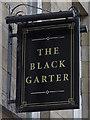 NZ2464 : Sign for The Black Garter, Clayton Street, NE1 by Mike Quinn
