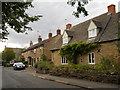 TF1205 : Cottages on Broad Wheel Road, Helpston by Paul Bryan