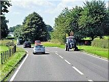 SJ8469 : Tractor on Congleton Road (A34) by David Dixon