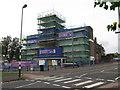 SP0795 : Shrouded in scaffolding still open-Kingstanding, Birmingham by Martin Richard Phelan