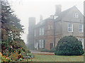 TF9434 : Great Snoring: Manor House, former Tudor Rectory, in autumn mist 1986 by Ben Brooksbank