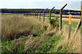TL1139 : Footpath by the barbed wire fence by Philip Jeffrey