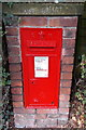 SJ8480 : King Edward VII postbox  in an Alderley Road hedge in Wilmslow by Jaggery