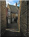 SP8797 : Lyddington: ironstone walls : Week 43