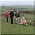 TV5197 : A conversation by the memorial to Canadian soldiers, killed in the Cuckmere valley, 1940 by Robin Stott