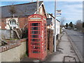 ST4505 : Mosterton: red telephone box by Chris Downer