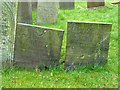 SK6929 : Hickling Churchyard - Belvoir Angel and other headstone by Alan Murray-Rust