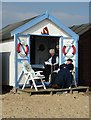 TM0112 : Taking time out at the beach hut by Neil Theasby