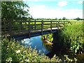 Dist:0.3km<br/>This wooden bridge carries a footpath over the River Wid near Ingatestone.  The Wid is a small river which flows through Essex countryside, until it flows into the River Can at Chelmsford.