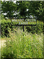 TM1381 : Walcot Green Farm sign by Adrian Cable