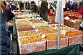 TF0920 : Fruit and nut stall at Bourne, Lincolnshire by Rex Needle