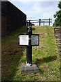SP0588 : Canalside marker post at All Saints by Richard Law