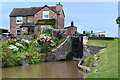 SJ6558 : Minshull Lock and cottage by David Martin