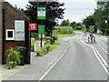 TF9632 : A148, Holt Road, Passing the Green Man at Little Snoring by David Dixon