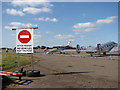 TM3295 : Warning sign at Seething Airfield by Evelyn Simak