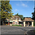 TL4055 : Barton: shoe shop, post office and bus shelter by John Sutton