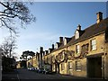 Listed buildings along the northeast side of the High Street at The Marketplace. On the right is the former Union Hotel http://list.historicengland.org.uk/resultsingle.aspx?uid=1090480&searchtype=mapsearch .
