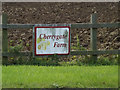 TM1164 : Cherrygate Farm sign by Adrian Cable