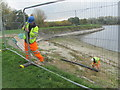 SP9114 : Repairing Startops Reservoir (2) Erecting Fencing by Chris Reynolds